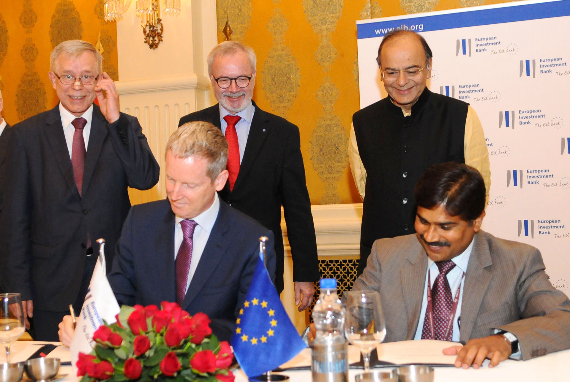 Union Minister for Finance and Corporate Affairs Arun Jaitley and President, European Investment Bank (EIB), Dr Werner Hoyer smile as the look over the signing ceremony of opening of the EIB's India office in New Delhi