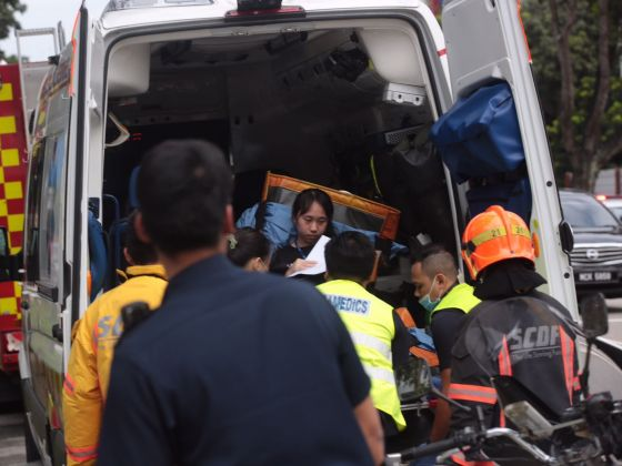 Injured people being rescued from the site of chemical leak at Kallang Way factory.