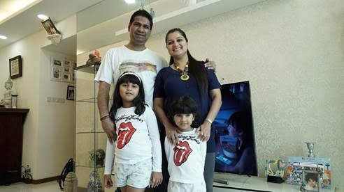 Mr Savio Coutinho and family, with their new Samsung 55-inch UHD Smart TV. Photo courtesy: Singtel TV