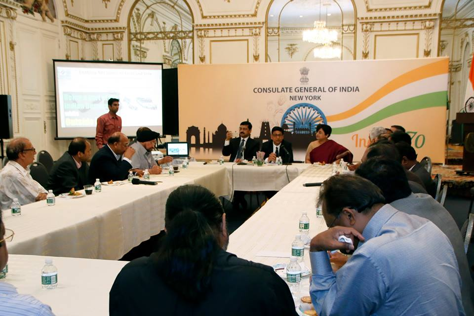 ECI senior members Sandeep Saxena (left) and Umesh Sinha (centre) in New York.