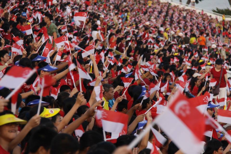 Singaporean people waving national flag