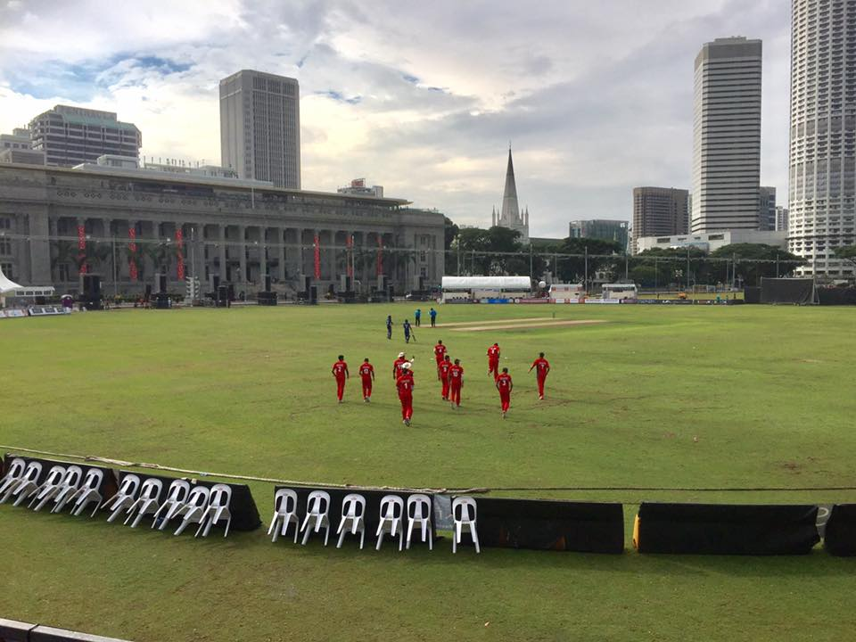SSC and KCC players take to the field at the Padang.