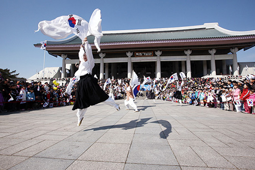 Crowds gather to watch a performance at the Independence Hall of Korea on National Liberation Day