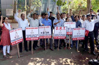 Employees of Kingisher Airlines belonging to Mallya demanding payment of salaries.