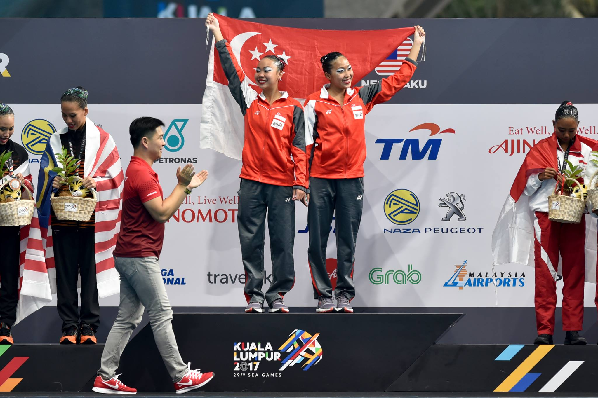18 August: Team Singapore Synchronised Swimming Duet Technical Routine Finals - Gold medallists Miya Yong and Debbie Soh at the Victory Ceremony. Photo courtesy: Andy Pascua