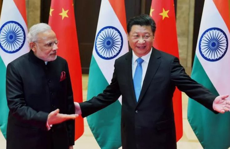 Indian Prime Minister Narendra Modi (right) with Chinese Premier Xi Jinping. Photo courtesy: BRICS