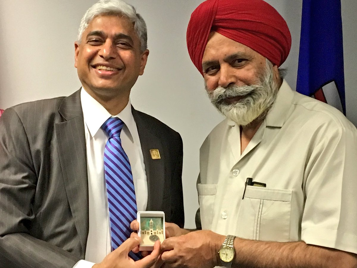 Calgary MP Darshan Kang (right) with Indian MEA official Vikas Swarup