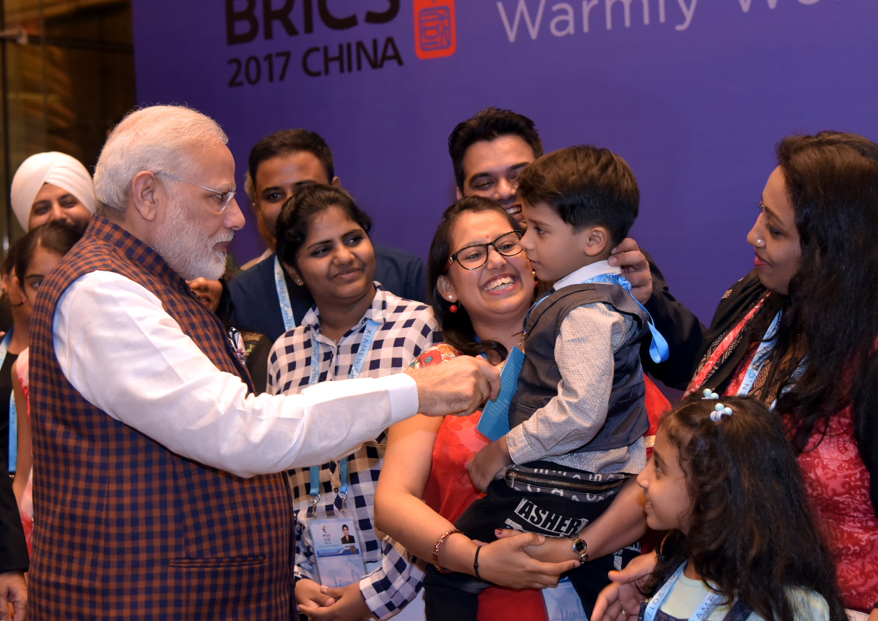 PM Modi interacting with NRIs at the Wyndham Hotel in Xiamen, China.