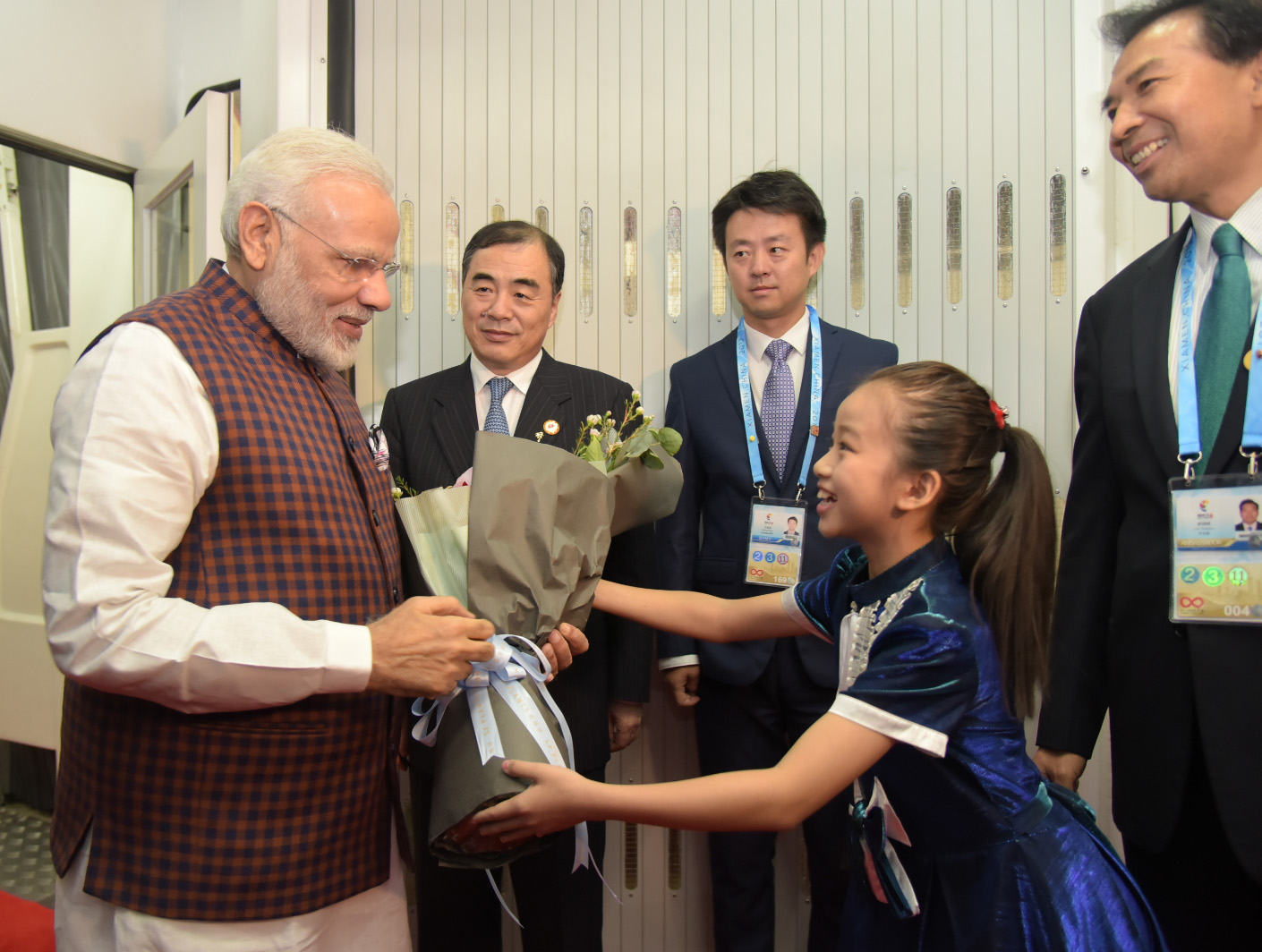 Prime Minister Narendra Modi greeted Chinese girl as he arrives at Xiamen Gaoqi International Airport