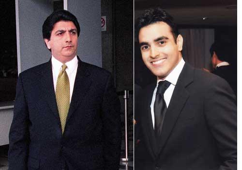Raj Kumar (left) and his son Kishin.