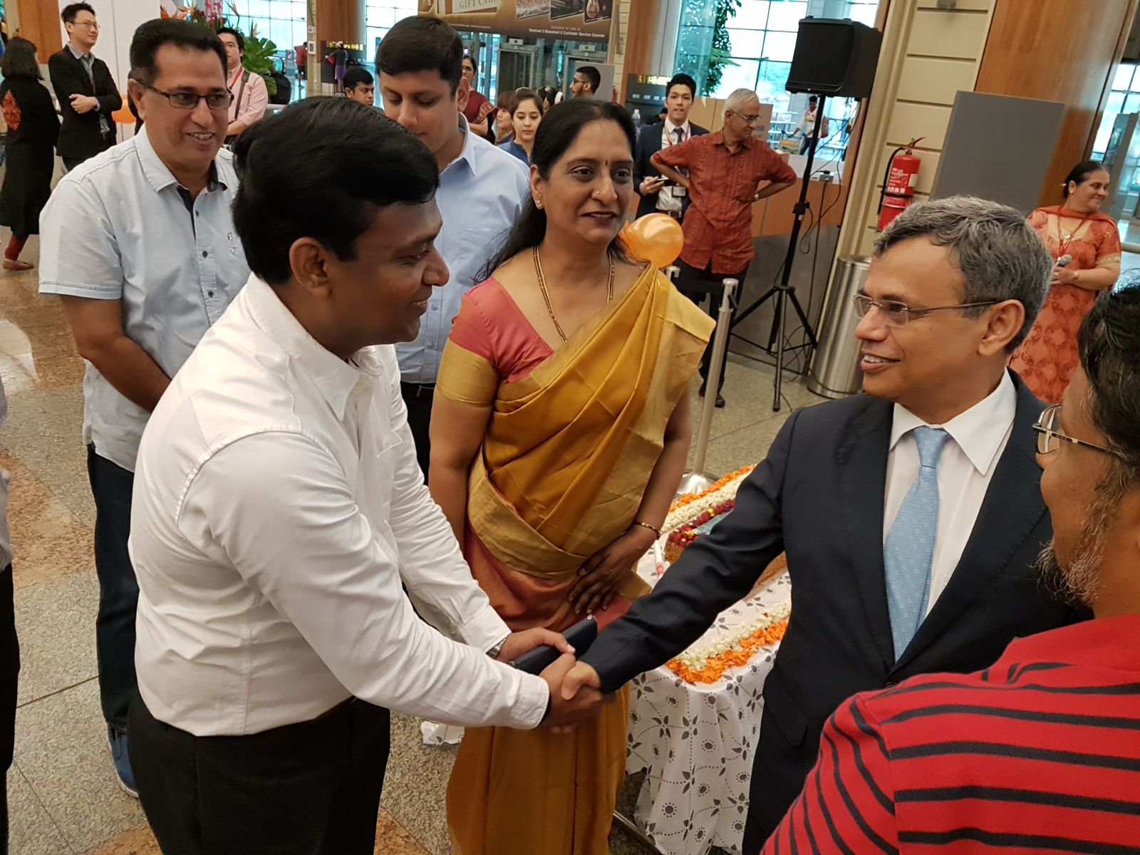 H.E. Jawed Ashraf, High Commissioner of India to Singapore (right) and Sowmya Srinivasan, Country Manager, Air India, Singapore ( middle) present during the launch of Singapore-Madurai flight at Changi Airport Terminal 2.