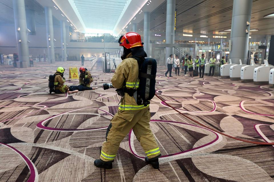 Airport Emergency Officers putting out the fire in the full dress rehearsal conducted at Terminal 4 at Changi Airport.