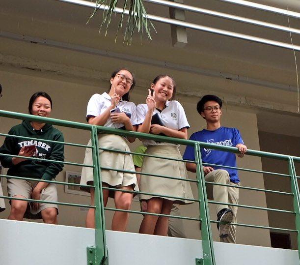 Pupils at Temasek Junior College waiting to see the Duchess of Cornwall Camilla.