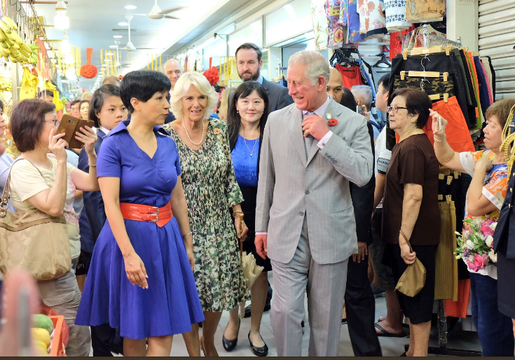 Prince Charles interacting with people at Tiong Bahru Market in Singapore.