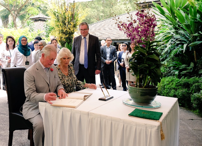 Prince Charles and his wife Camilla participating in an orchid naming ceremony at Botanic Gardens.