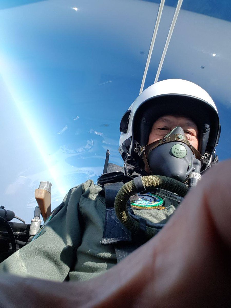 Singapore's Minister for Defence Dr Ng Eng Hen takes a selfie in the cockpit of the Tejas aircraft.