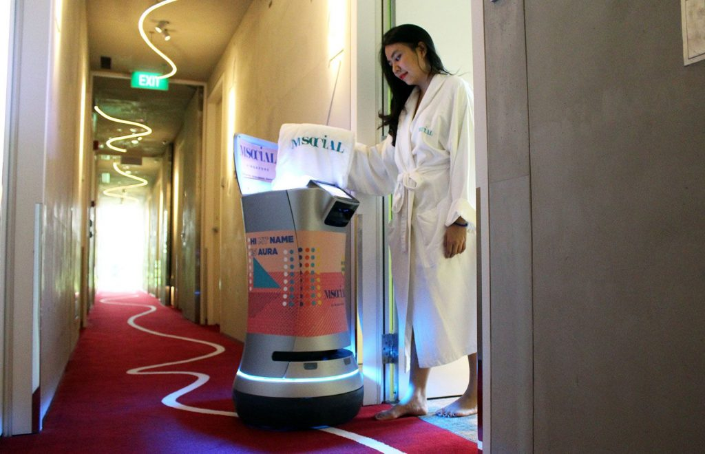AURA is capable of delivering bottled water, towels, toiletries and other products in hotels.
