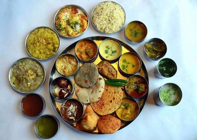 The elaborate thali comprises of dal baati churma, missi roti, gatte ki sabji, panchmela dal, laal maas, bajra roti, buttermilk and desserts like malpuas and halwa