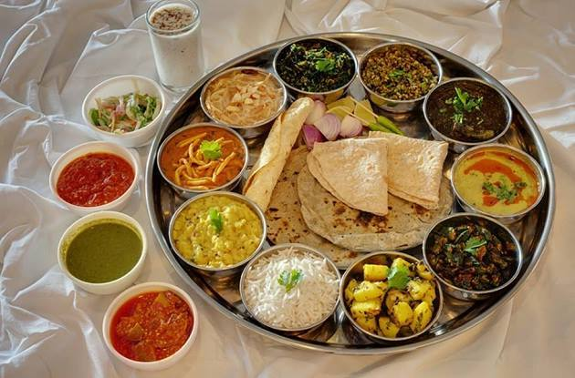 The state's thali comprises of dishes that are sweet and tangy, namely methi na thepla, bhakhri, khatti mithi daal (sweet and sour lentil), aloo rasila, steamed rice, badshahi #khichdi etc