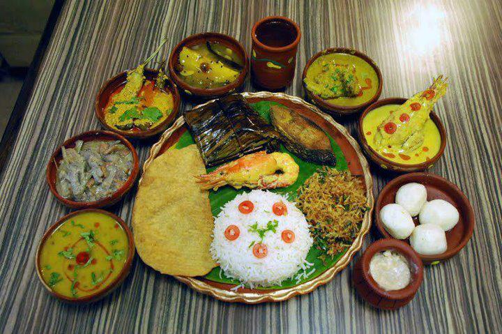 Fish, vegetables, potol bhaja, torkari, doi maach, kebabs, rice, lentils, chor chori, sandesh etc. form the basic ingredients of Bengali thali