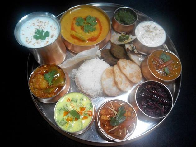 The state's trademark thali comprises of delicacies such as rakhia badi, pethas, rice pakodas, bafauri, steamed rice, fara (crispy balls made with leftover cooked rice)