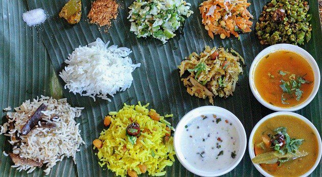 The thali comprises of healthy mix of rice, akki roti, dal, vegetables, rasam, sambar, vada, kosambari (salad), rava kesari (dessert) & high infusion of coconut