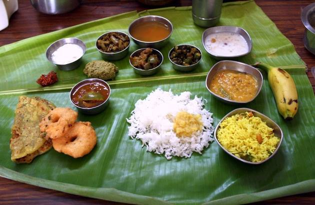 High on red chillies and spices, Andhra thali offers food which is simple yet packed with flavours, ranging from rasam, chutney, vada, rice and more