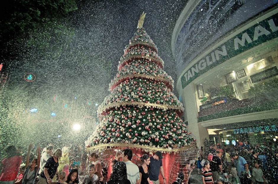 Snow made of foam is showered at the Tanglin Mall.