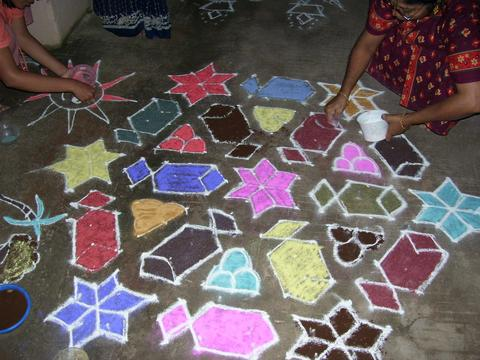 Kolam is drawn in front of houses.