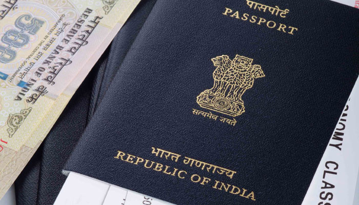 Currently, the first page of the passport has the photograph as well as other details of the passport holder; the address is printed on the last page.