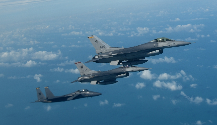 An RSAF F-15SG and two F-16s flying in close formation. Photo courtesy: MINDEF