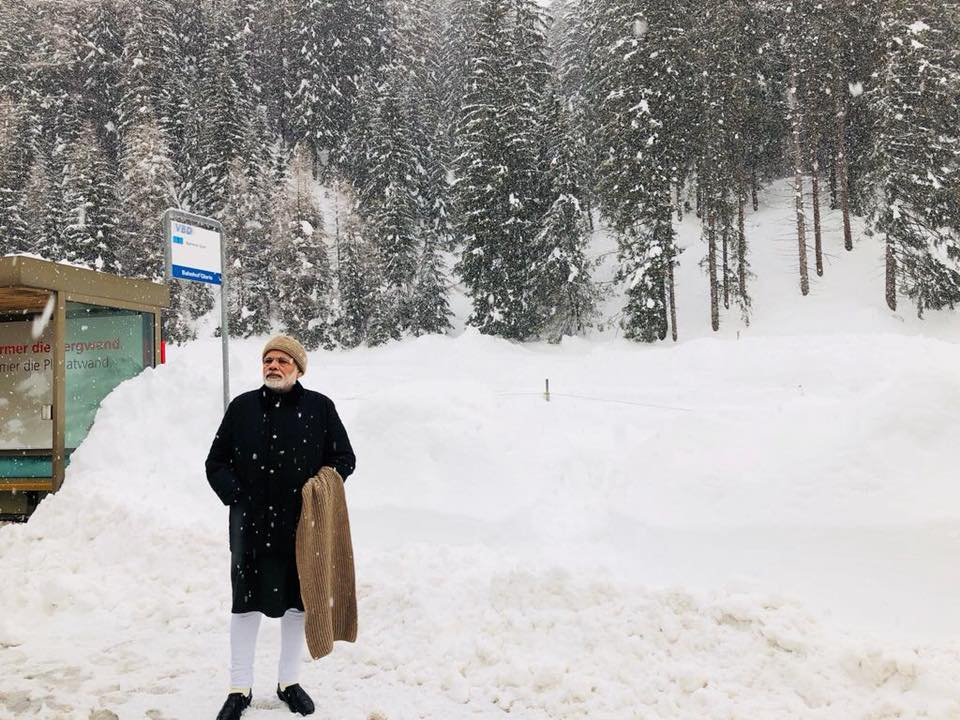 Indian Prime Minister Narendra Modi standing at the snow clad city of Davos where he is participating in the World Economic Forum meeting.