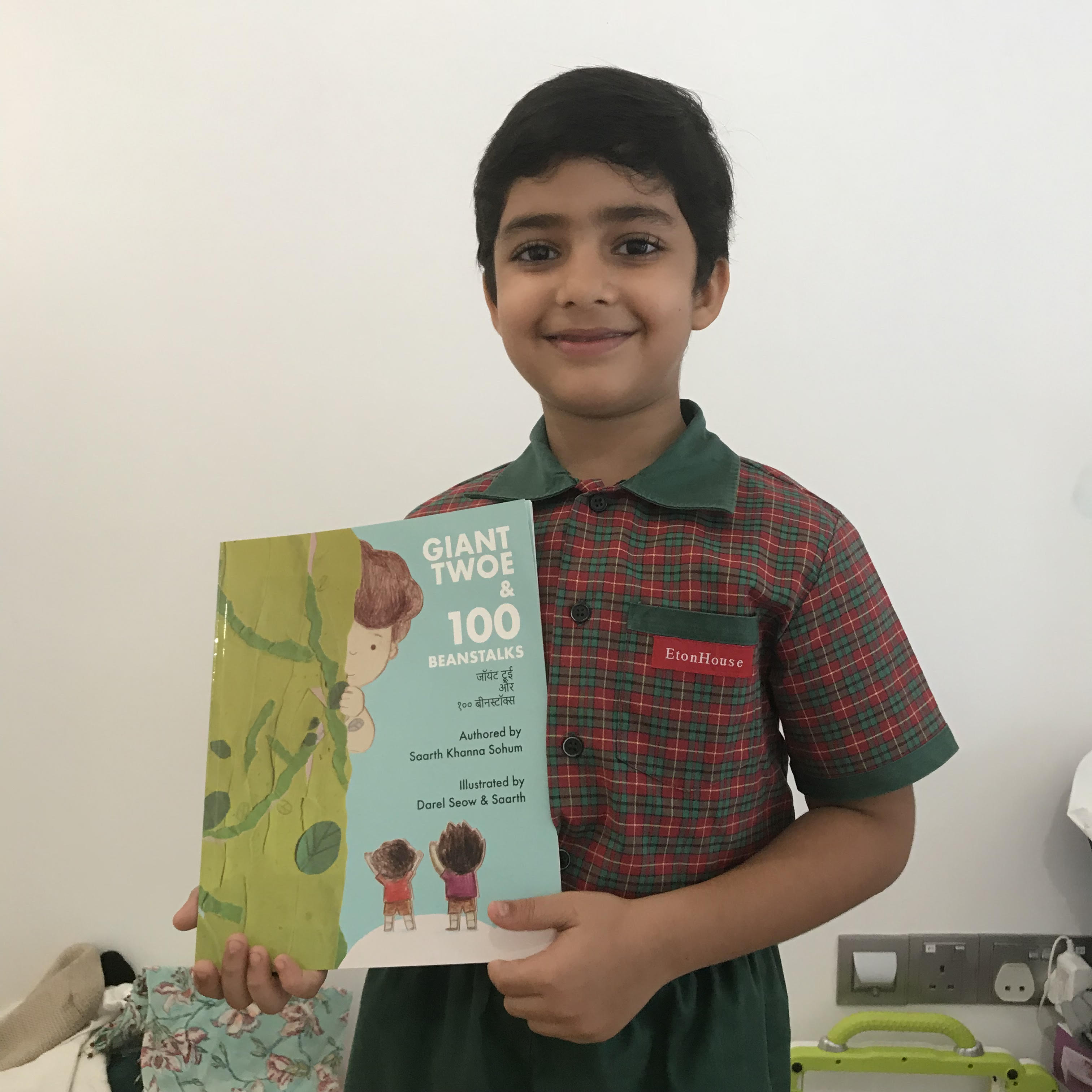 Saarth Khanna Sohum with the book he has written, 'Giant Twoe and 100 Beanstalks'.