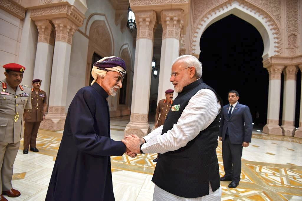 Indian Prime Minister Narendra Modi holding hands of Sultan Qaboos of Oman signifying closer bonds between India and Oman.