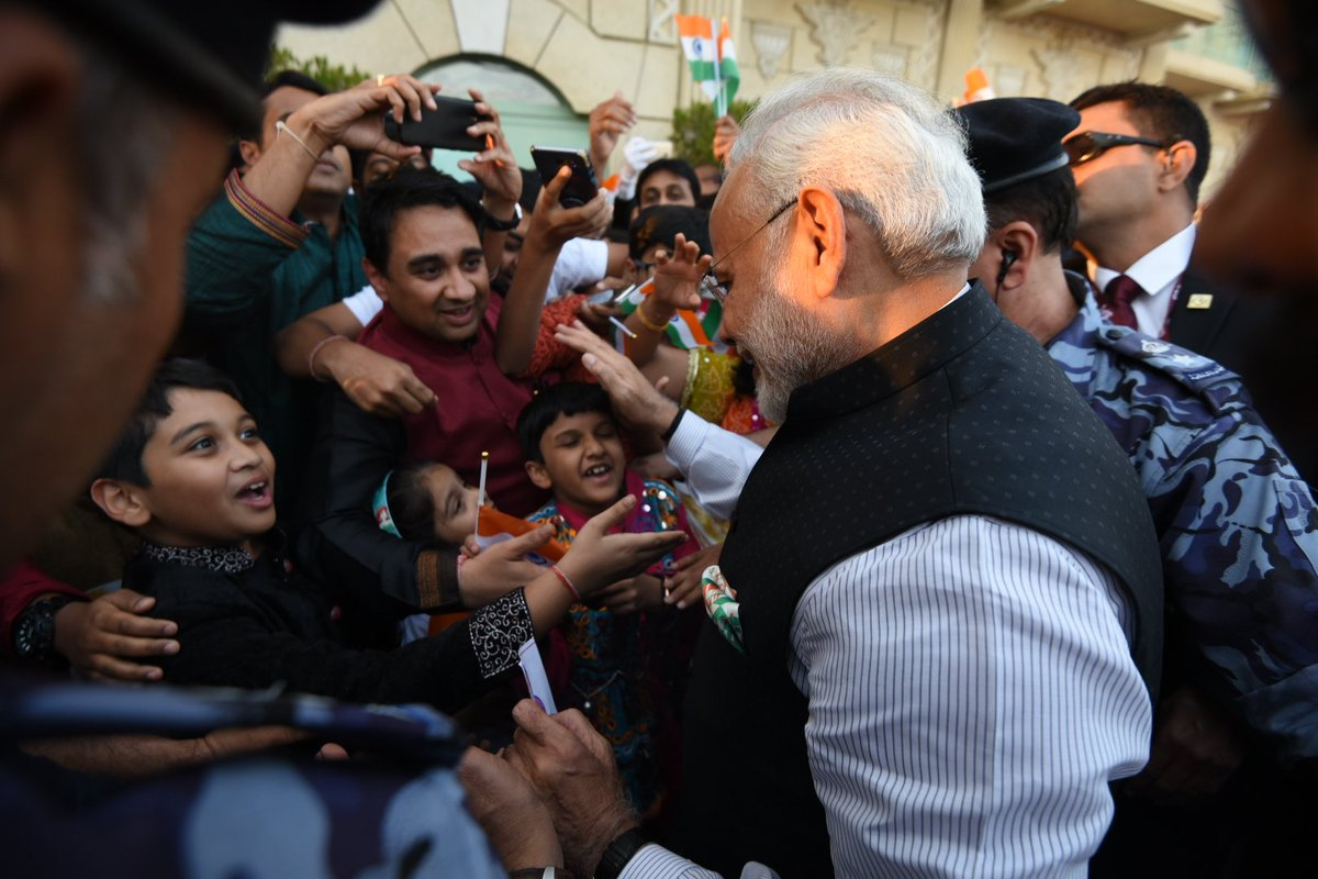 Children of Indian community enthusiastically welcoming Prime Minister Narendra Modi on his arrival at the hotel in Muscat.