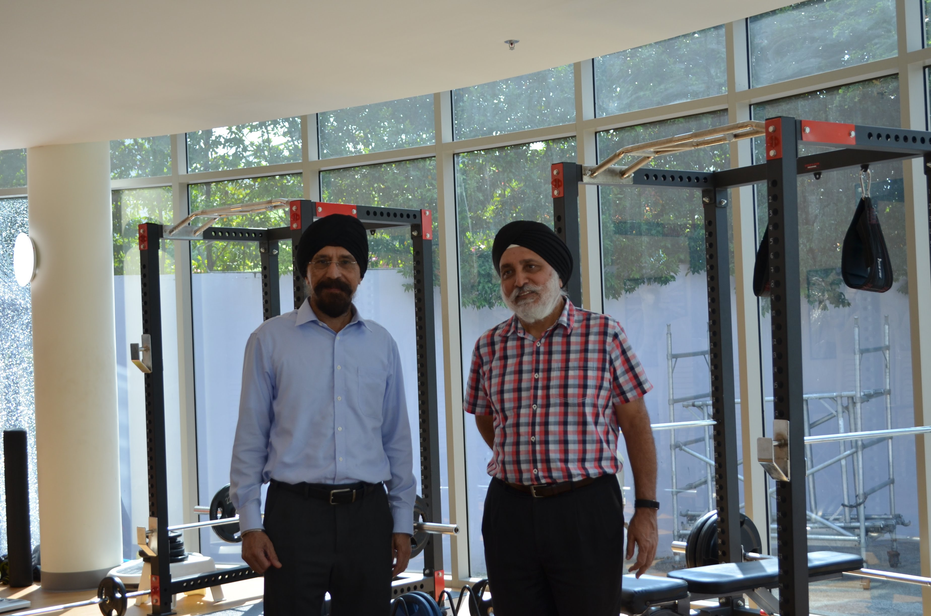 Mohinder Singh (left), seen here with SKA GM Albel Singh in the association's gym.