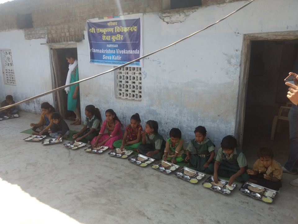 Kids taking lunch at meals cum education centres for children called 'Sri Ramakrishna Vivekananda Seva Kutir' in Madhya Pradesh.