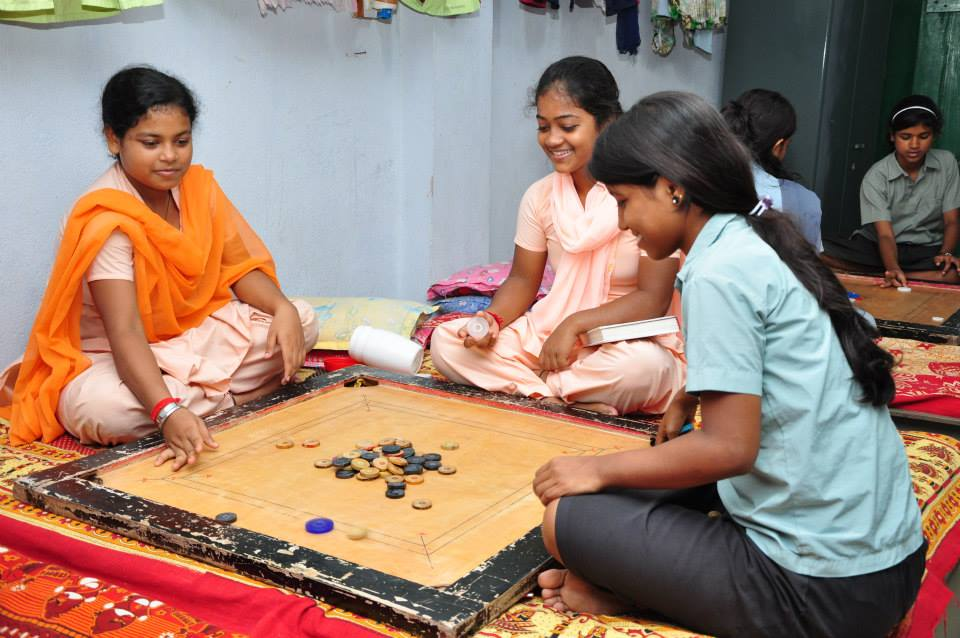 Students playing carrom during their free time at Parivaar.