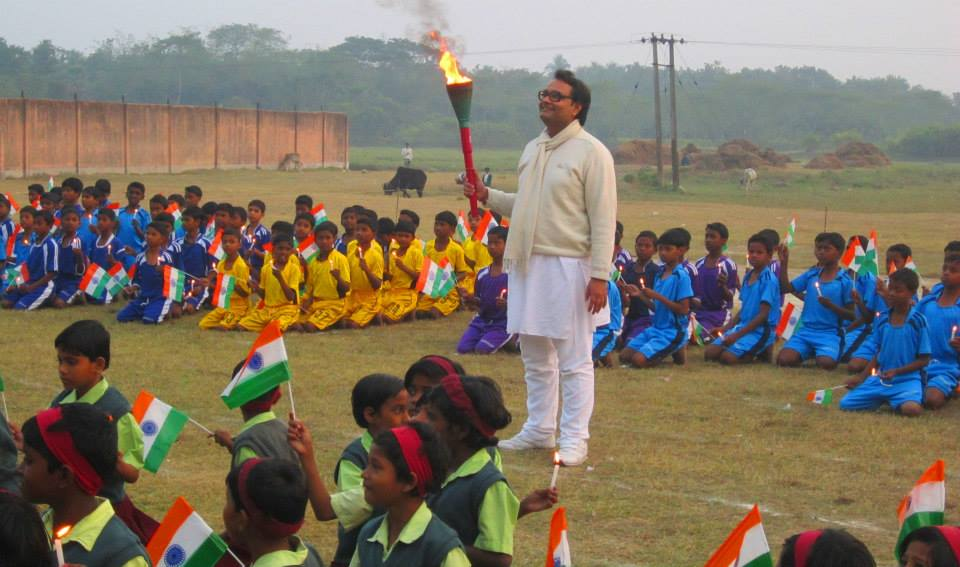 Vinayak Lohani holding the torch at the annual Athletic Meet at Parivaar metaphorically urging the students to stand up and express the vast potential hidden inside them.