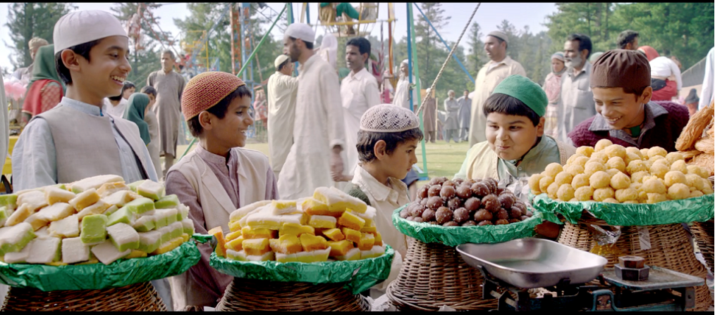 The scene of the delicious sweets tempts children but the orphan boy Hamid purchases tongs for his grandmother which is effectively portrayed in the film. Photo courtesy: DIFF