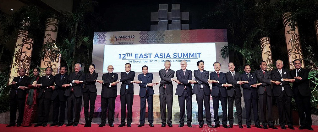 Leaders from the Association of Southeast Asia Nations (ASEAN) chaired by President Rodrigo Roa Duterte along with the leaders of the dialogue partner countries do the ASEAN handshake as they pose for a photo prior to the start of 12th East Asia Summit at the Philippine International Convention Center on November 14, 2017.
