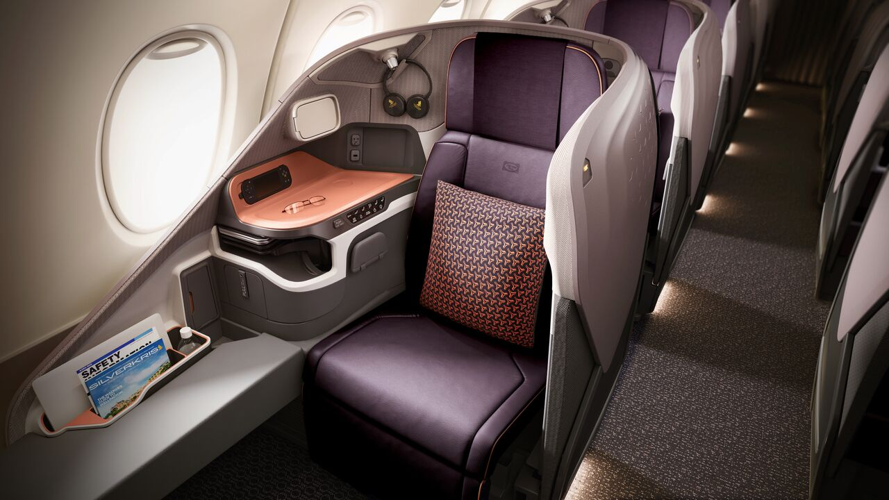 The new 'business class' seat of Singapore Airlines  which has two side wings for better back support. It reclines directly into a comfortable full-flat bed.