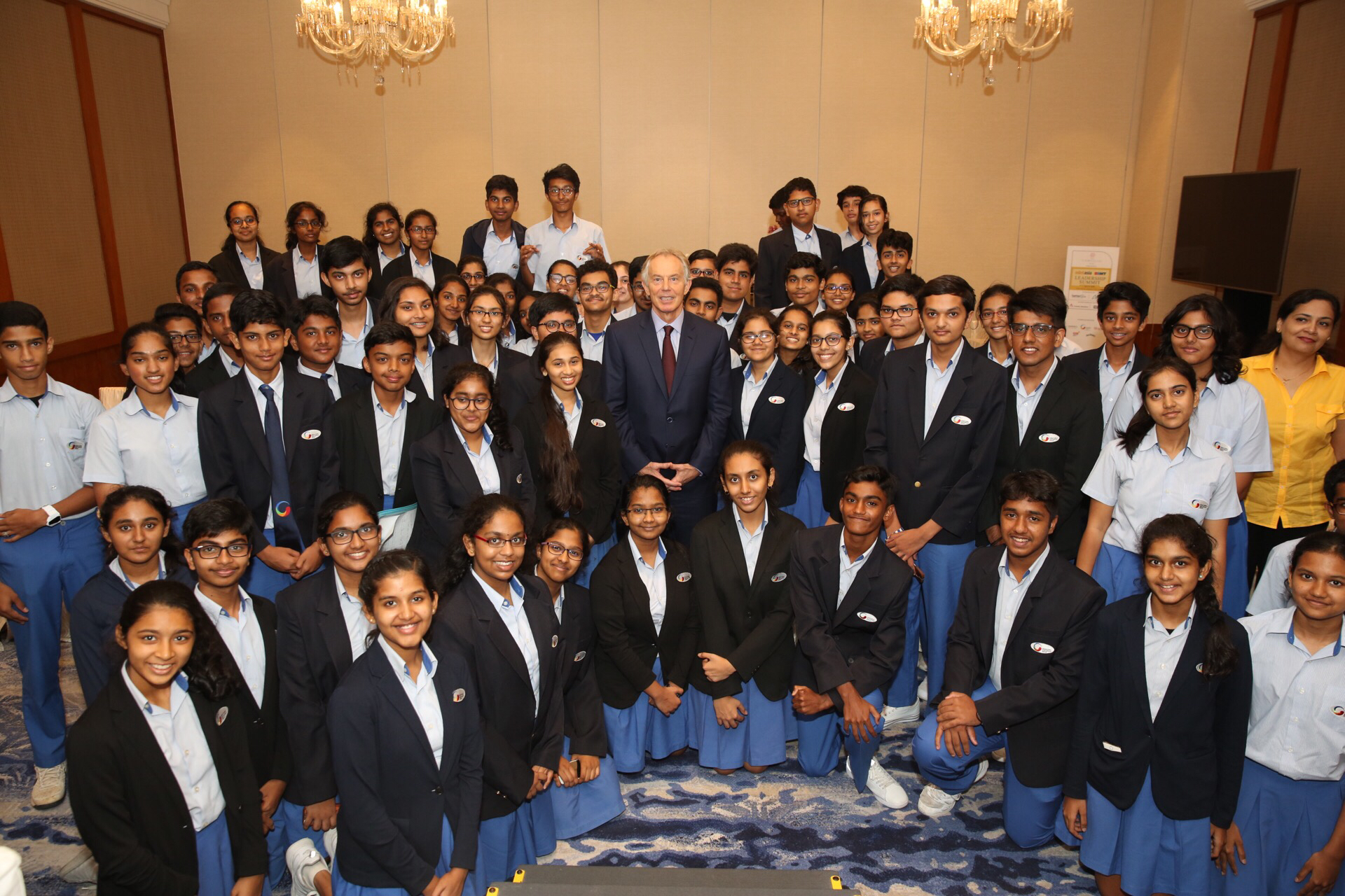 Tony Blair (centre) interacting with GIIS students.