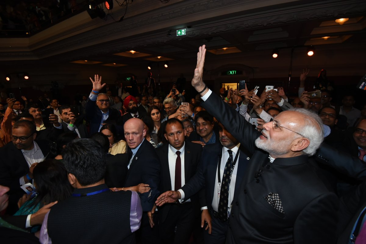 Indian PM Narendra Modi being cheered by overseas Indians at the 'Bharat ki Baat' event in London.