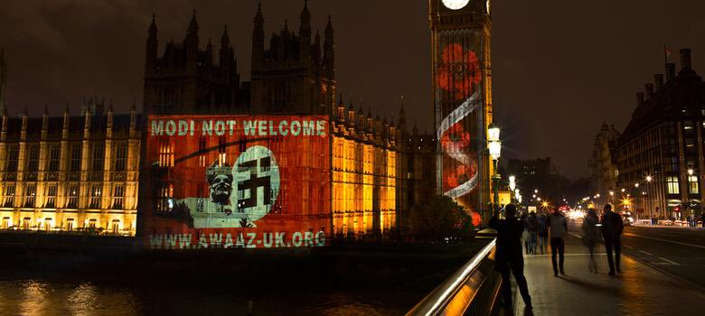 A projection in London highlighting the protests against Modi.