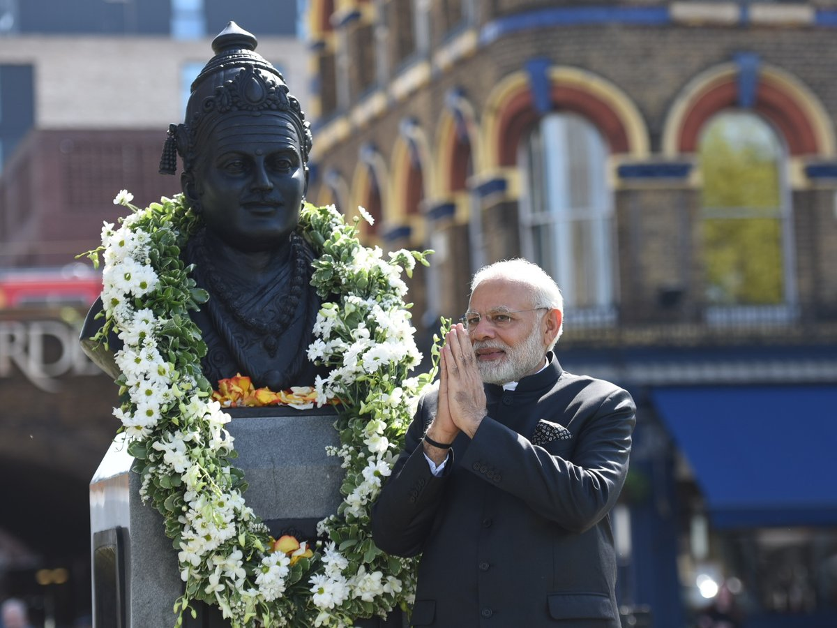 PM Modi with UK PM Theresa May at the Crick Institute (top) and garlanding the Basaveshwara statue yesterday