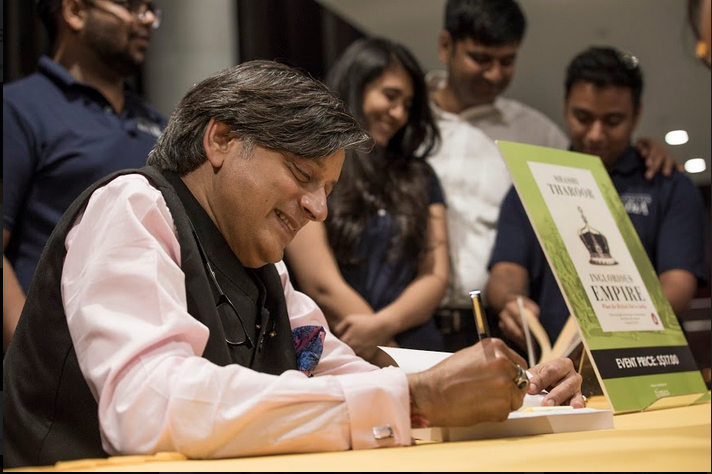Dr Shashi Tharoor patiently signing almost 100 copies of Inglorious Empire for the fans. Photo: Connected to India