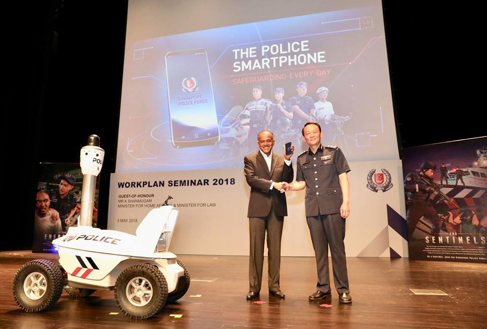 Singapore Law and Home Affairs Minister K. Shanmugam (left) at the launch of the new police smartphone during the Police Workplan Seminar. Photo courtesy: Facebook/@SingaporePoliceForce
