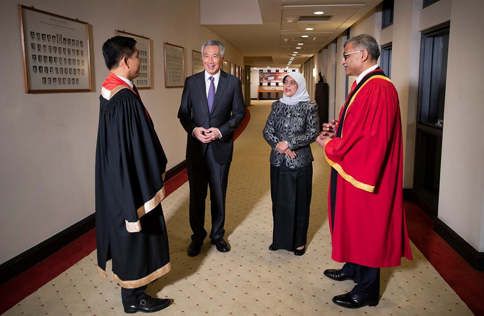 Prime Minister of Singapore Lee Hsien Loong interacting with President Halimah Yacob, Speaker Tan Chuan-Jin, and Chief Justice Sundaresh Menon during opening of second session of the 13th Parliament.