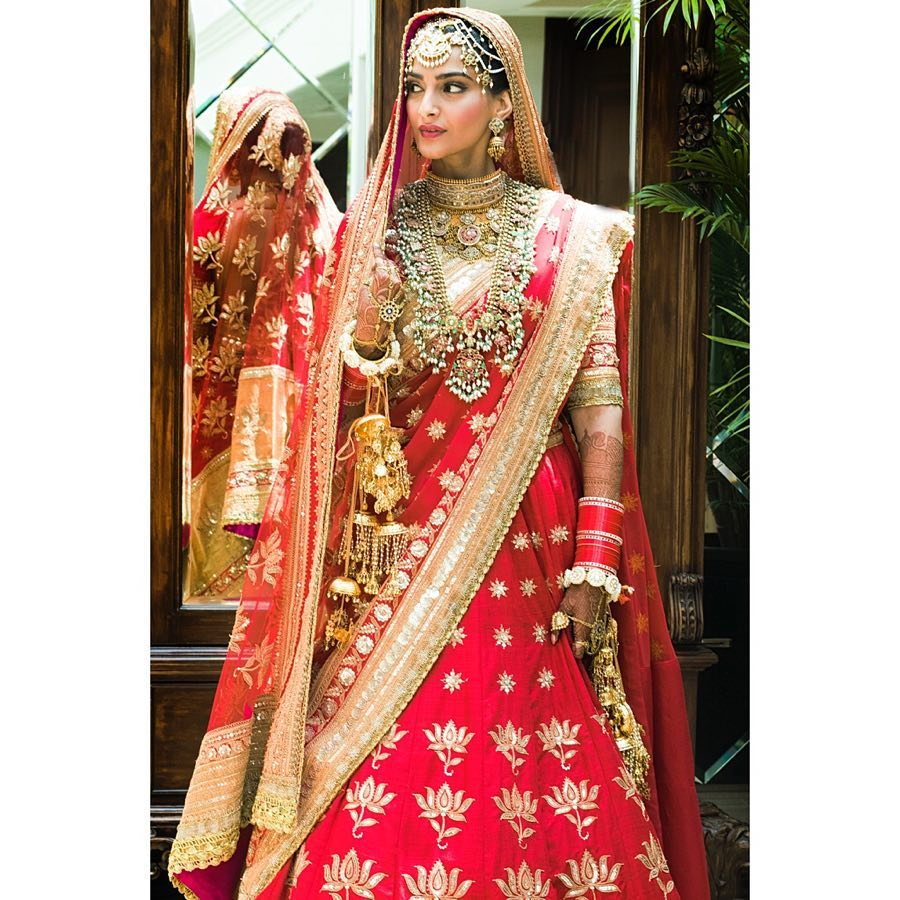 Sonam looked stunning in traditional bright pink lehenga.
